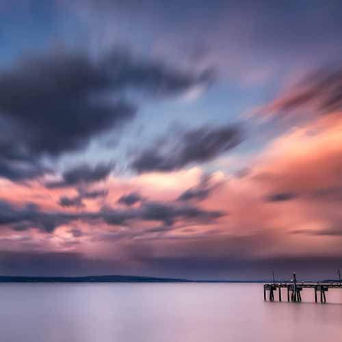 Lila Wolken Tapete mit Meerblick