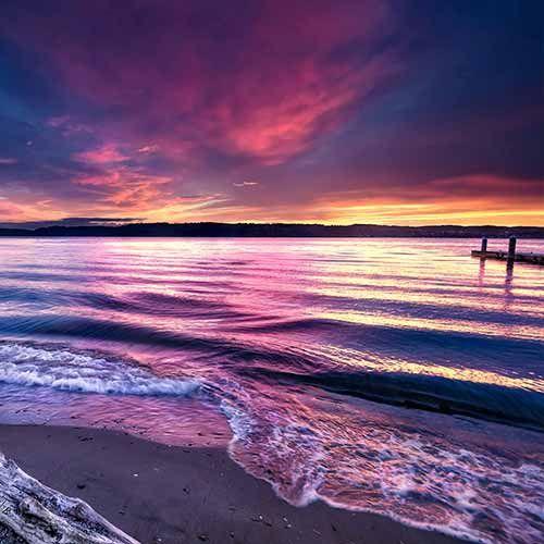 Sonnenuntergang Lila Himmel am Strand Tapete